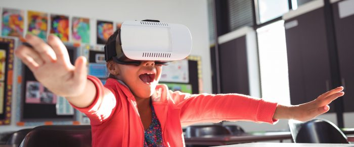 Girl with mouth open using virtual reality glasses